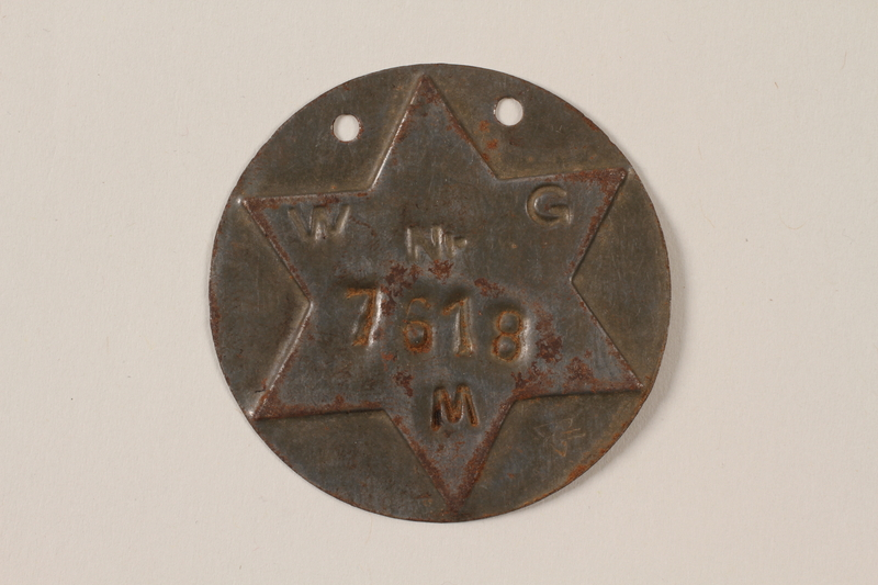 1995.89.1090 front Jewish Ghetto Police badge from the Kovno ghetto