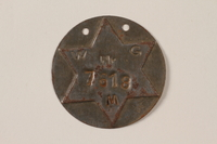1995.89.1090 front Jewish Ghetto Police badge from the Kovno ghetto  Click to enlarge