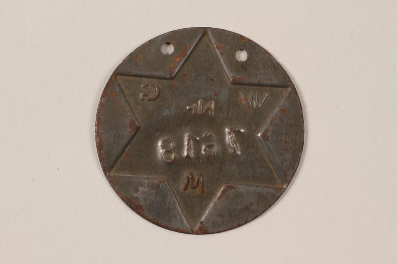 1995.89.1090 back Jewish Ghetto Police badge from the Kovno ghetto