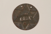 1995.89.1090 back Jewish Ghetto Police badge from the Kovno ghetto  Click to enlarge
