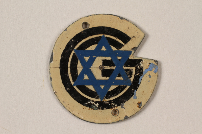 1995.89.1092 front Metal Star of David badge with the letter G