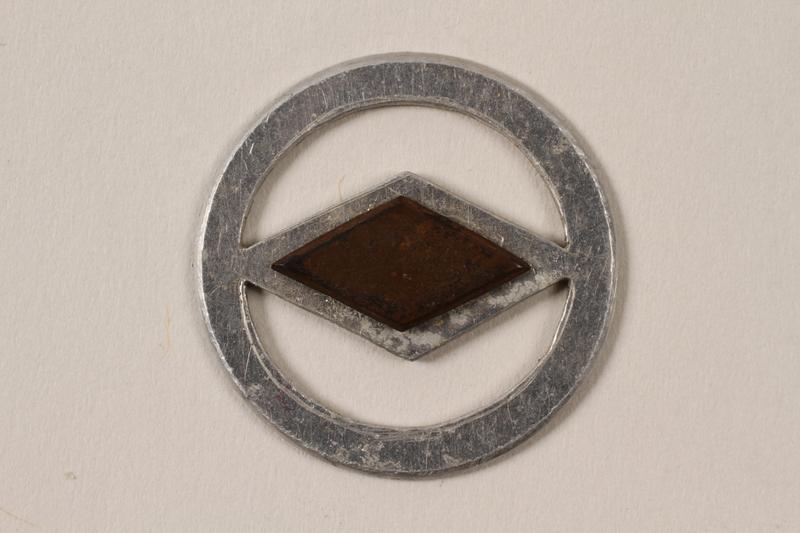 1995.89.1093 front Jewish Ghetto Police badge from the Kovno ghetto