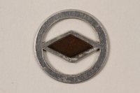 1995.89.1093 front Jewish Ghetto Police badge from the Kovno ghetto  Click to enlarge
