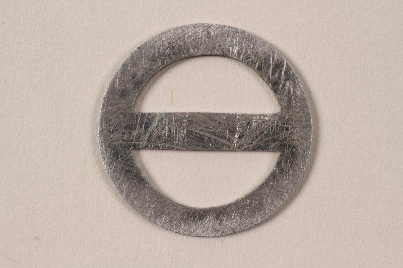 1995.89.1094 front Circular metal D ring with crossbar