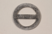 1995.89.1094 front Circular metal D ring with crossbar  Click to enlarge