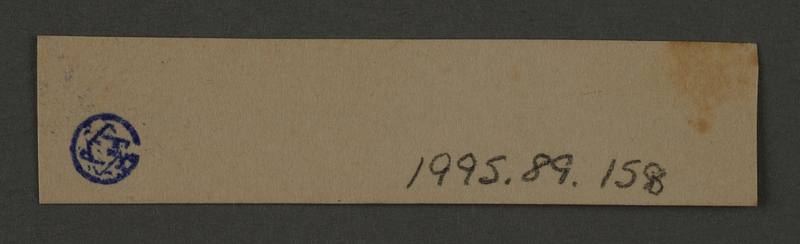 1995.89.158 back Ink stamp impression from an administrative department of the Kovno ghetto