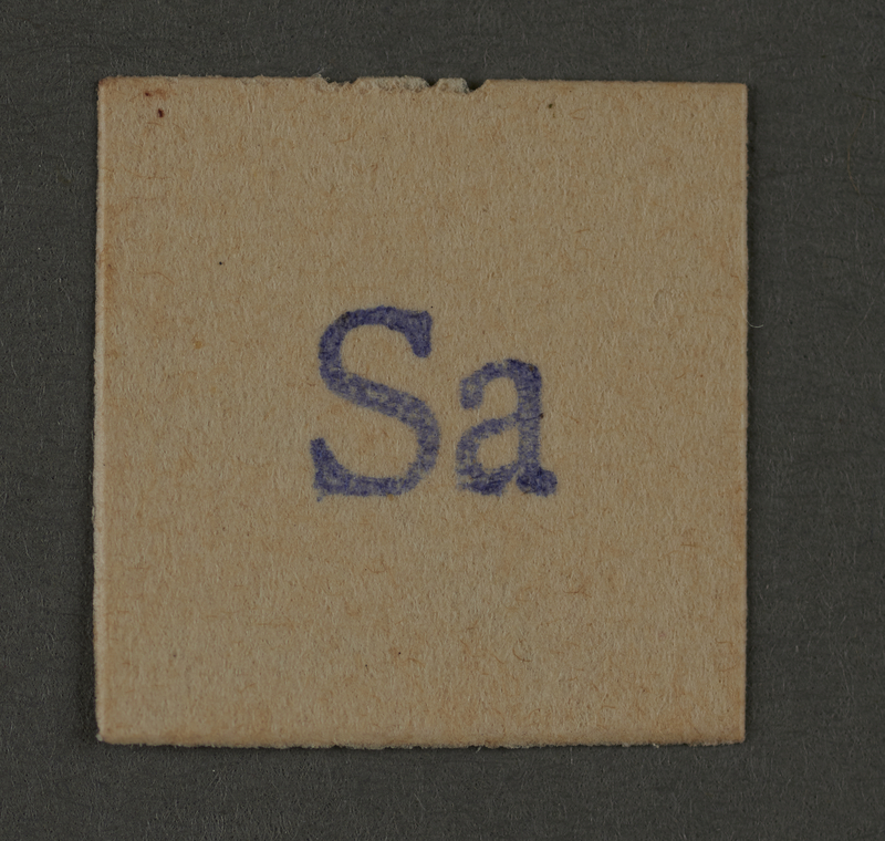 1995.89.161 front Ink stamp impression from an administrative department of the Kovno ghetto