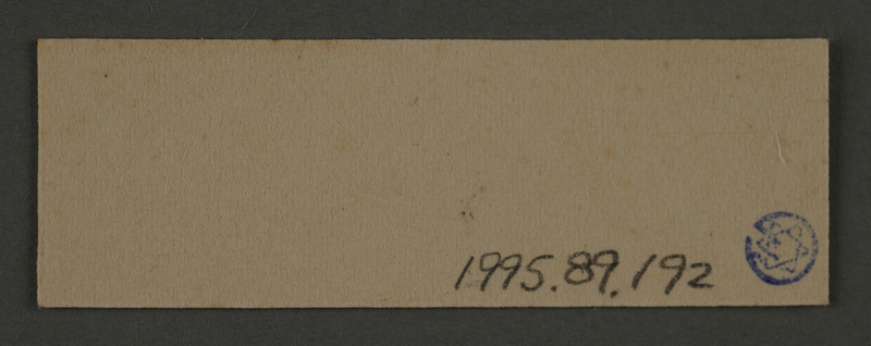 1995.89.192 back Ink stamp impression likely from the school department of the Kovno ghetto