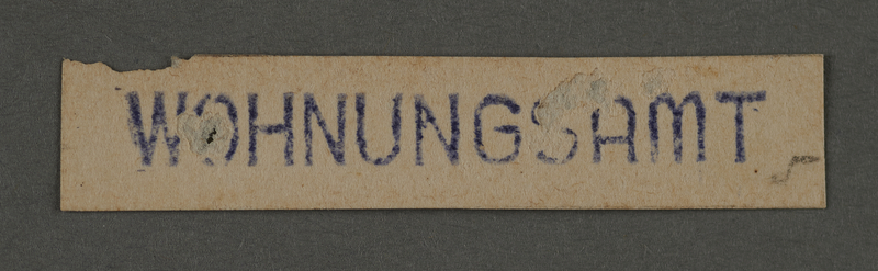1995.89.193 front Ink stamp impression from the housing office of the Kovno ghetto