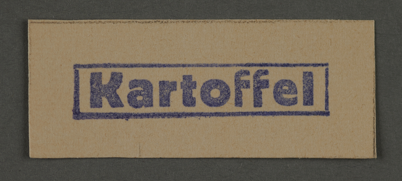 1995.89.206 front Ink stamp impression from an administrative department of the Kovno ghetto