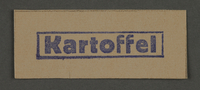 1995.89.206 front Ink stamp impression from an administrative department of the Kovno ghetto  Click to enlarge