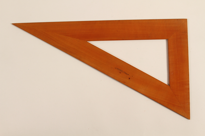 1989.303.16 back Wooden drafting triangle used by a Czech Jewish camp inmate