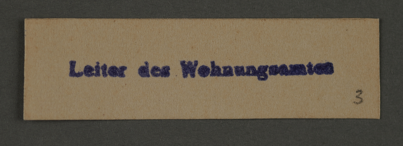 1995.89.219 front Ink stamp impression for the leader of the Housing Office in the Kovno ghetto