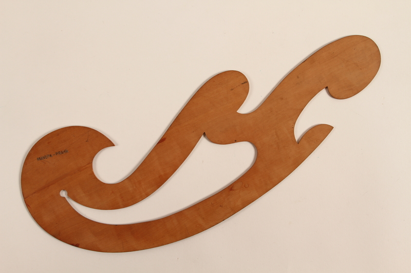 1989.303.17 front French curve drafting tool used by a Czech Jewish camp inmate