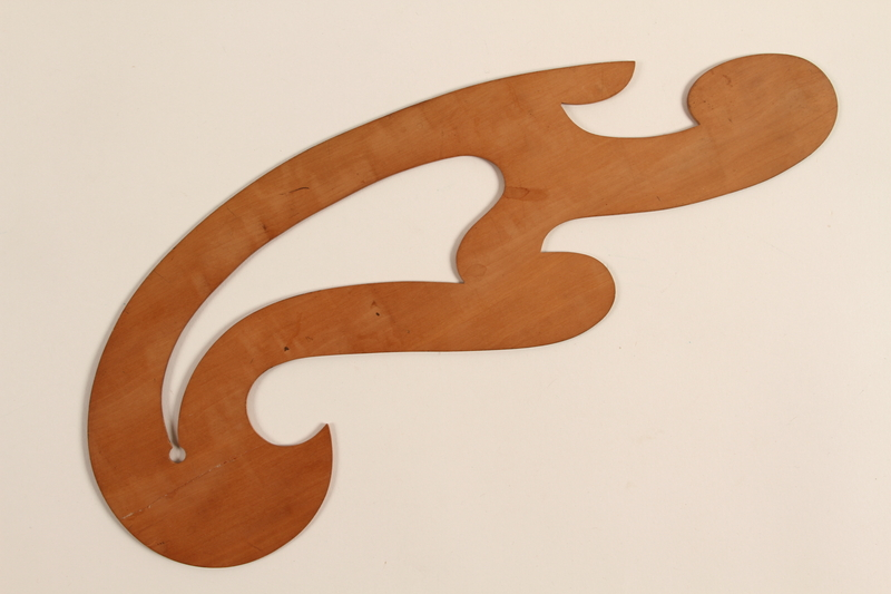 1989.303.17 back French curve drafting tool used by a Czech Jewish camp inmate