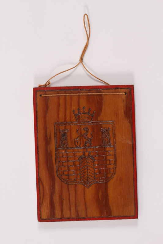 1989.303.19 front Wooden tile withTerezin coat of arms made by a Czech Jewish inmate