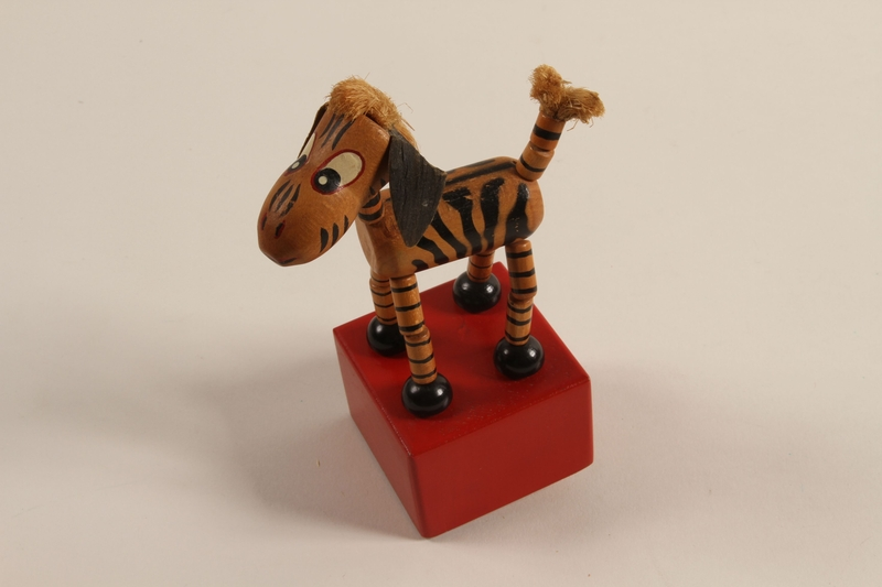 1989.303.20 front Zebra push puppet made by a former Jewish Czech camp inmate