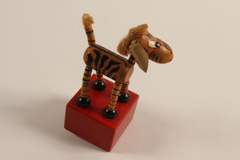 1989.303.20 back Zebra push puppet made by a former Jewish Czech camp inmate