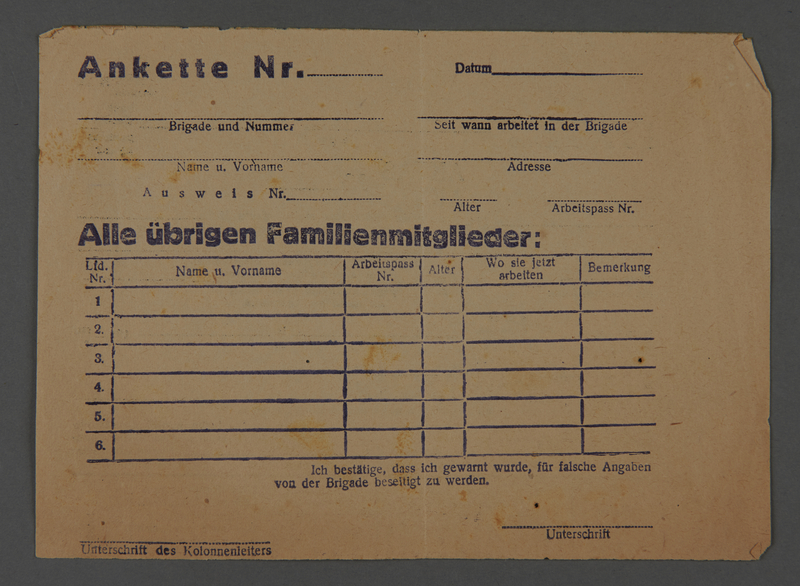 1995.89.264 front Personal identification document from the Kovno ghetto which identifies a worker and his/her family members and their places of work