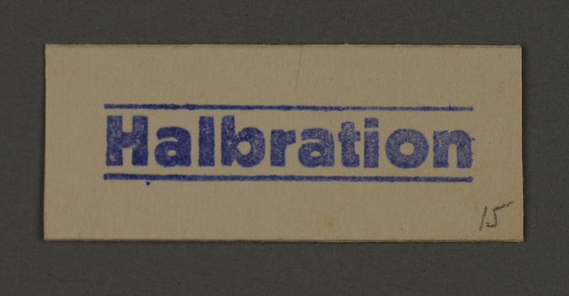 1995.89.274 front Ink stamp impression from an administrative department of the Kovno ghetto