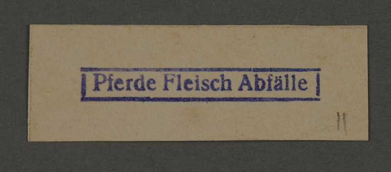 1995.89.278 front Ink stamp impression from an administrative department of the Kovno ghetto