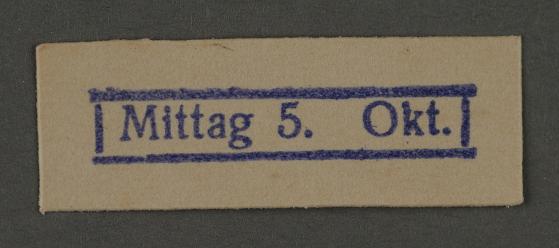 1995.89.279 front Ink stamp impression from an administrative department of the Kovno ghetto