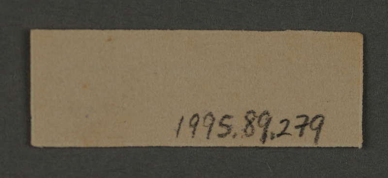 1995.89.279 back Ink stamp impression from an administrative department of the Kovno ghetto