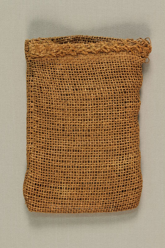 1989.303.23 front Burlap purse made from a mattress cover by a Jewish Czech concentration camp inmate