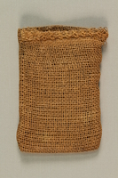 1989.303.23 front Burlap purse made from a mattress cover by a Jewish Czech concentration camp inmate  Click to enlarge