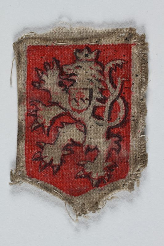 1989.303.26 front Patch with the Bohemian lion made by a Jewish Czech concentration camp inmate
