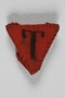 Inverted red triangle patch with T made by a Jewish Czech concentration camp inmate