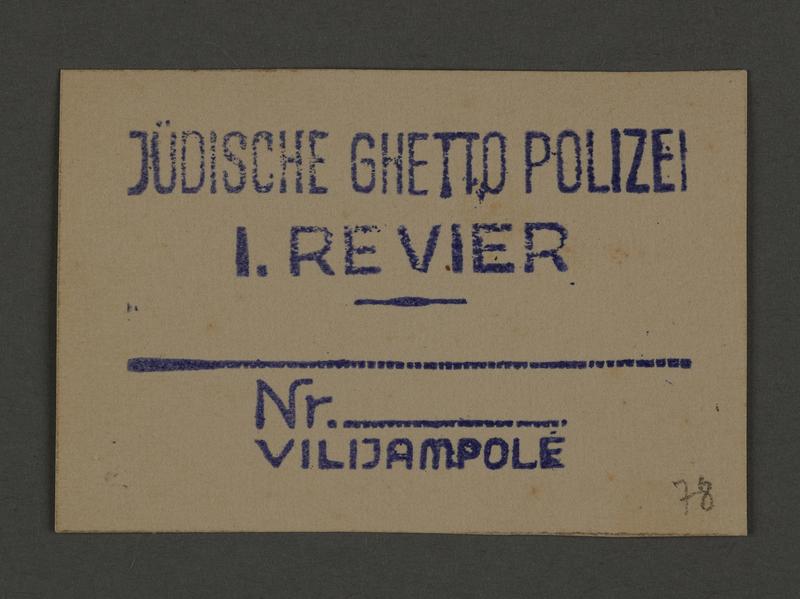 1995.89.349 front Permit stamp impression from the Jewish Ghetto Police, Precinct 1, of the Kovno ghetto