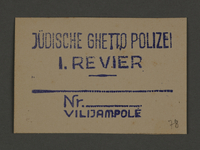 1995.89.349 front Permit stamp impression from the Jewish Ghetto Police, Precinct 1, of the Kovno ghetto  Click to enlarge