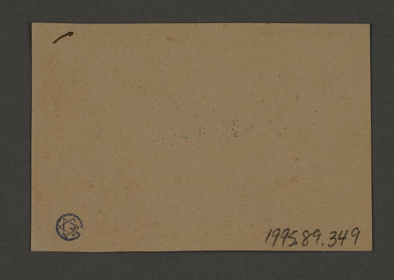 1995.89.349 back Permit stamp impression from the Jewish Ghetto Police, Precinct 1, of the Kovno ghetto