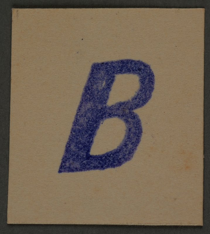 1995.89.401 front Letter stamp from an administrative department of the Kovno ghetto