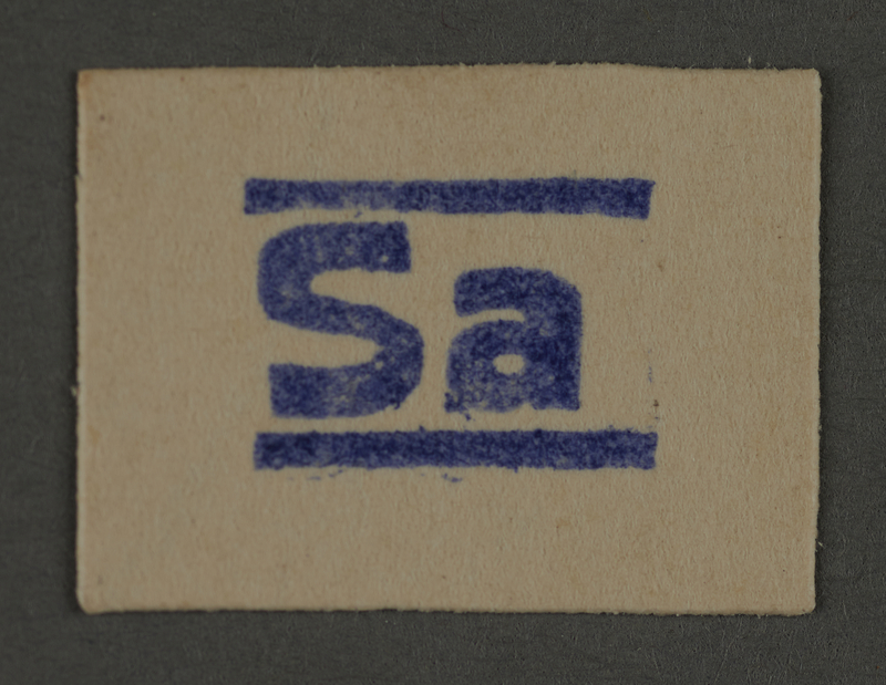 1995.89.404 front Ink stamp impression from an administrative department of the Kovno ghetto