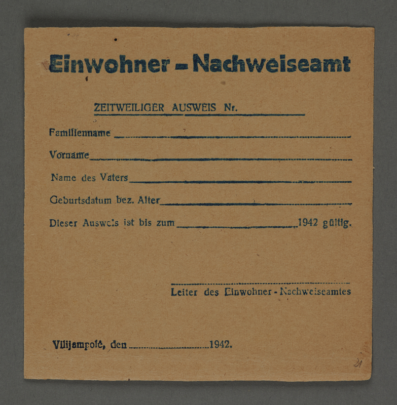 1995.89.438 front Temporary certificate for housing assignment issued in the Kovno ghetto