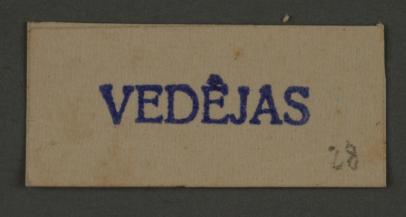 1995.89.454 front Ink stamp impression from an administrative department of the Kovno ghetto