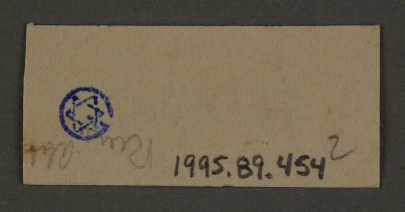 1995.89.454 back Ink stamp impression from an administrative department of the Kovno ghetto