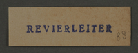1995.89.470 front Ink stamp impression used by the Precinct Head of the Kovno ghetto  Click to enlarge