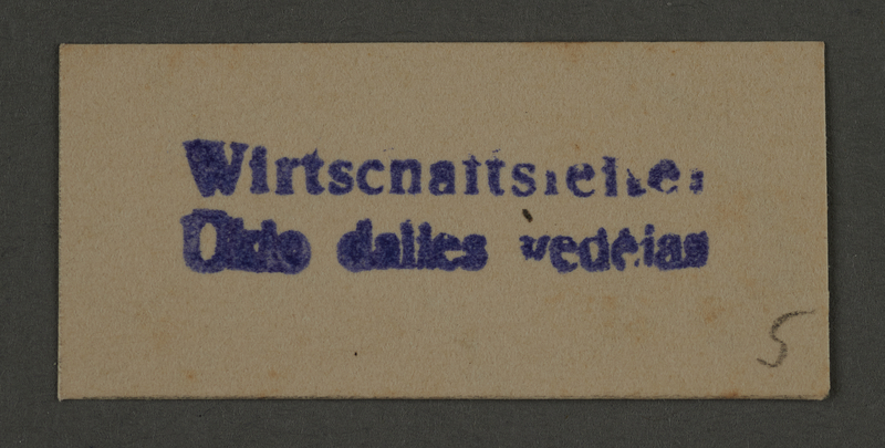 1995.89.473 front Ink stamp impression from an administrative department of the Kovno ghetto
