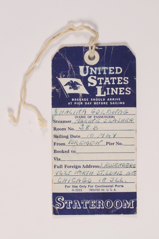 2014.426.5 front Blue and white United States Line luggage tag used by a Polish Jewish refugees