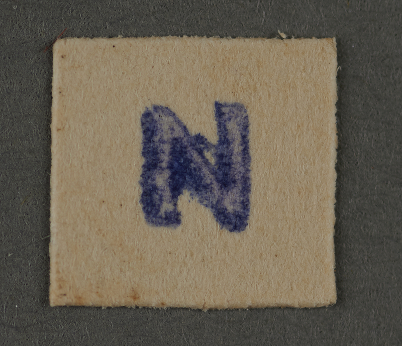 1995.89.515 front Ink stamp impression from an administrative department of the Kovno ghetto