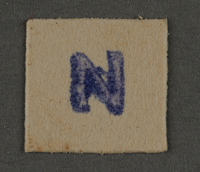 1995.89.515 front Ink stamp impression from an administrative department of the Kovno ghetto  Click to enlarge