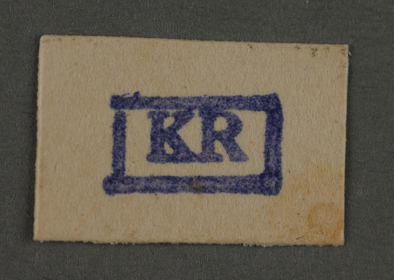 1995.89.516 front Ink stamp impression from an administrative department of the Kovno ghetto