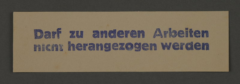 1995.89.532 front Exemption card from work in the Kovno ghetto