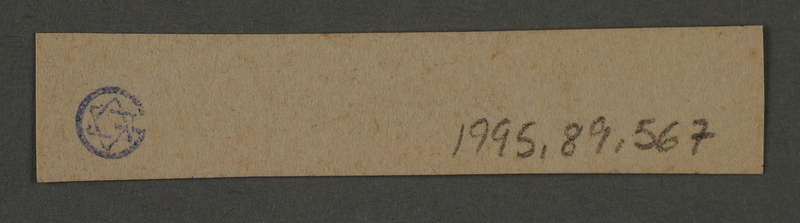 1995.89.567 back Ink stamp impression used by the Criminal Department of the Kovno ghetto