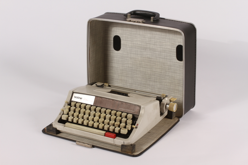2007.522.2 a-b open Brother typewriter with metal case and Yiddish type