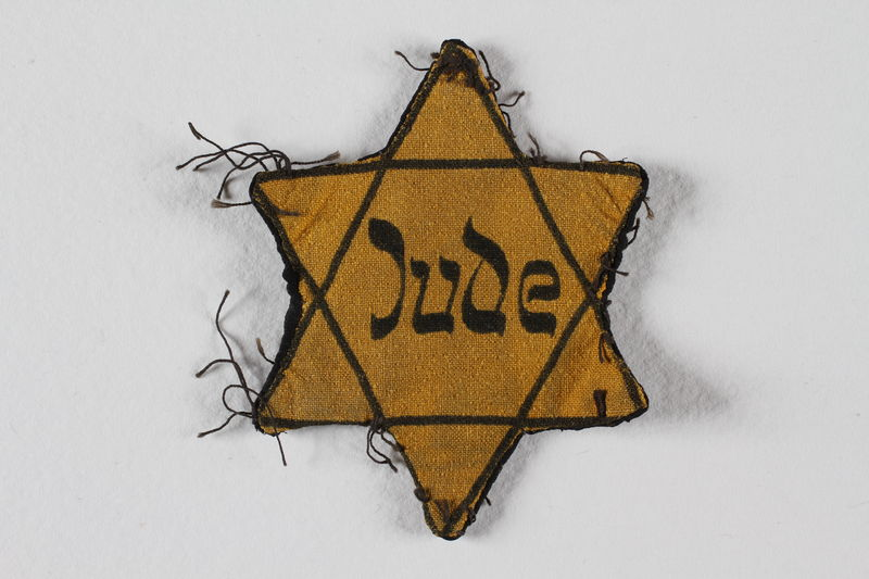1989.303.54 front Star of David badge with Jude owned by Czech Jewish concentration camp prisoners