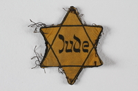 1989.303.54 front Star of David badge with Jude owned by Czech Jewish concentration camp prisoners  Click to enlarge